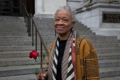 "This is Juliette. The rose she is holding fell off Marion Barry's casket as the casket was being transported. ""Marion Barry is important to the history of Washington DC. I came here in 1967 and his activism and contributions were always present since I've arrived. And not just in the city. Many people of wealth in Prince George's county benefited from Marion Barry's programs and contracts. And not only contracts - many major companies survived on opportunities for capital created by Marion Barry. He opened capital to black people in particular and other people of color - he diversified access to capital."