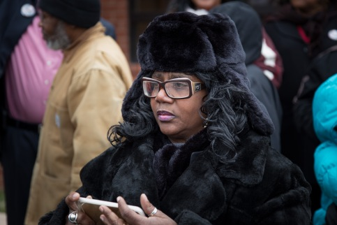 A woman waits to take Marion Barry's picture as the casket arrives at Temple of Praise.